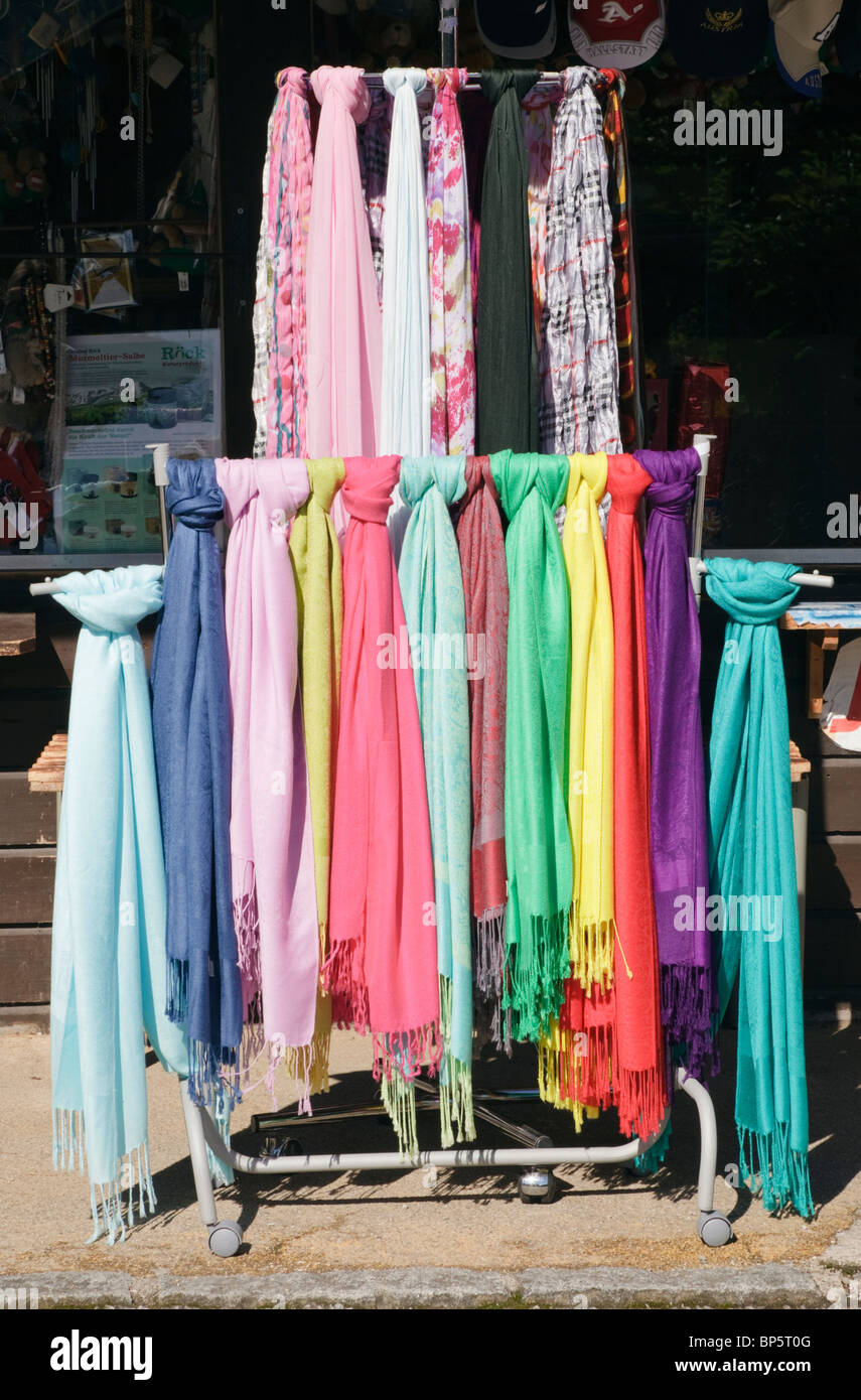 colourful scarves for sale hanging on a display stand