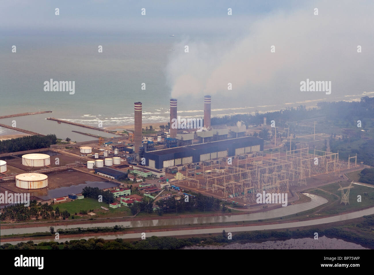 aerial view above smoke stacks electrical power generation plant northeastern Mexico Stock Photo