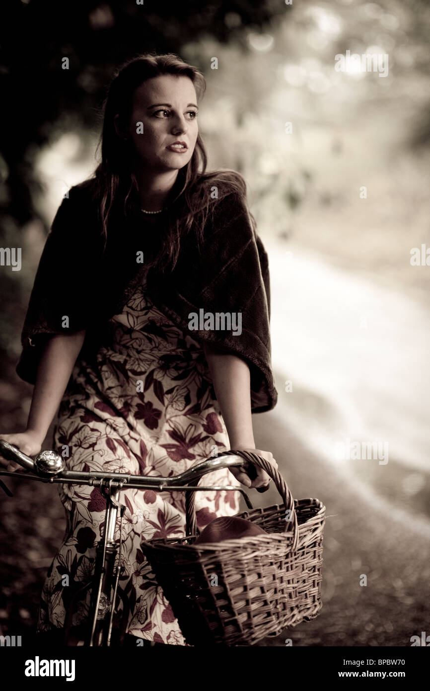 Girl with a bicycle in a vintage 1940 style Stock Foto