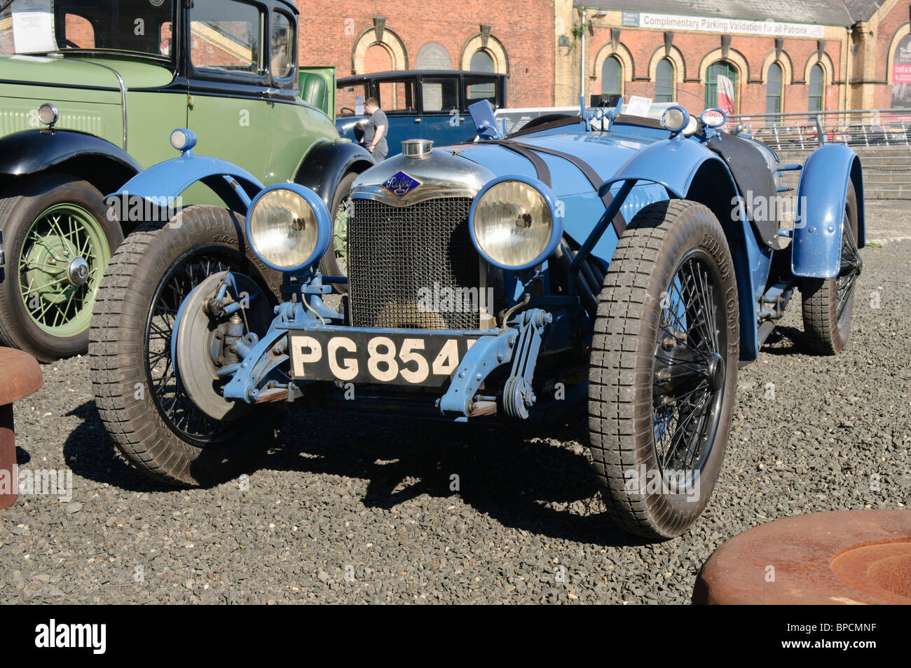 Riley brooklands sports car at a classic car rally stock for Sell em all motors