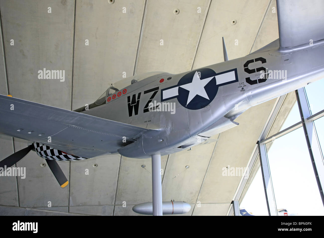 A P51 Mustang Fighter Plane On Display Hanging From The