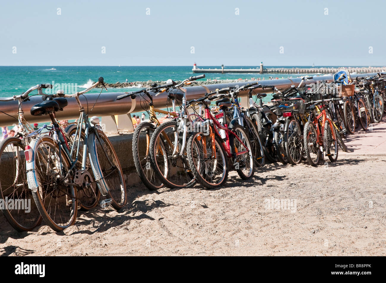 Many bikes along the beach during a beautiful day Stock Photo