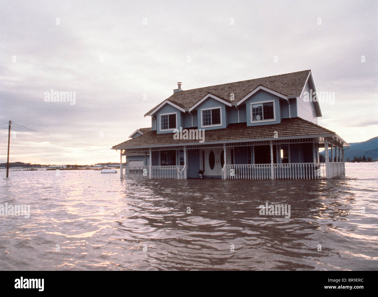 house surrounded by flood water stock photo royalty free