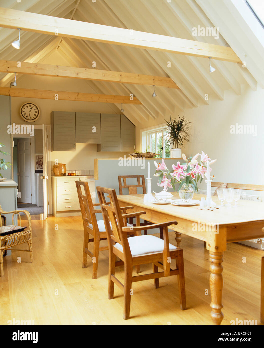 Wooden chairs and pine table in traditional kitchen in for Traditional wooden kitchen chairs