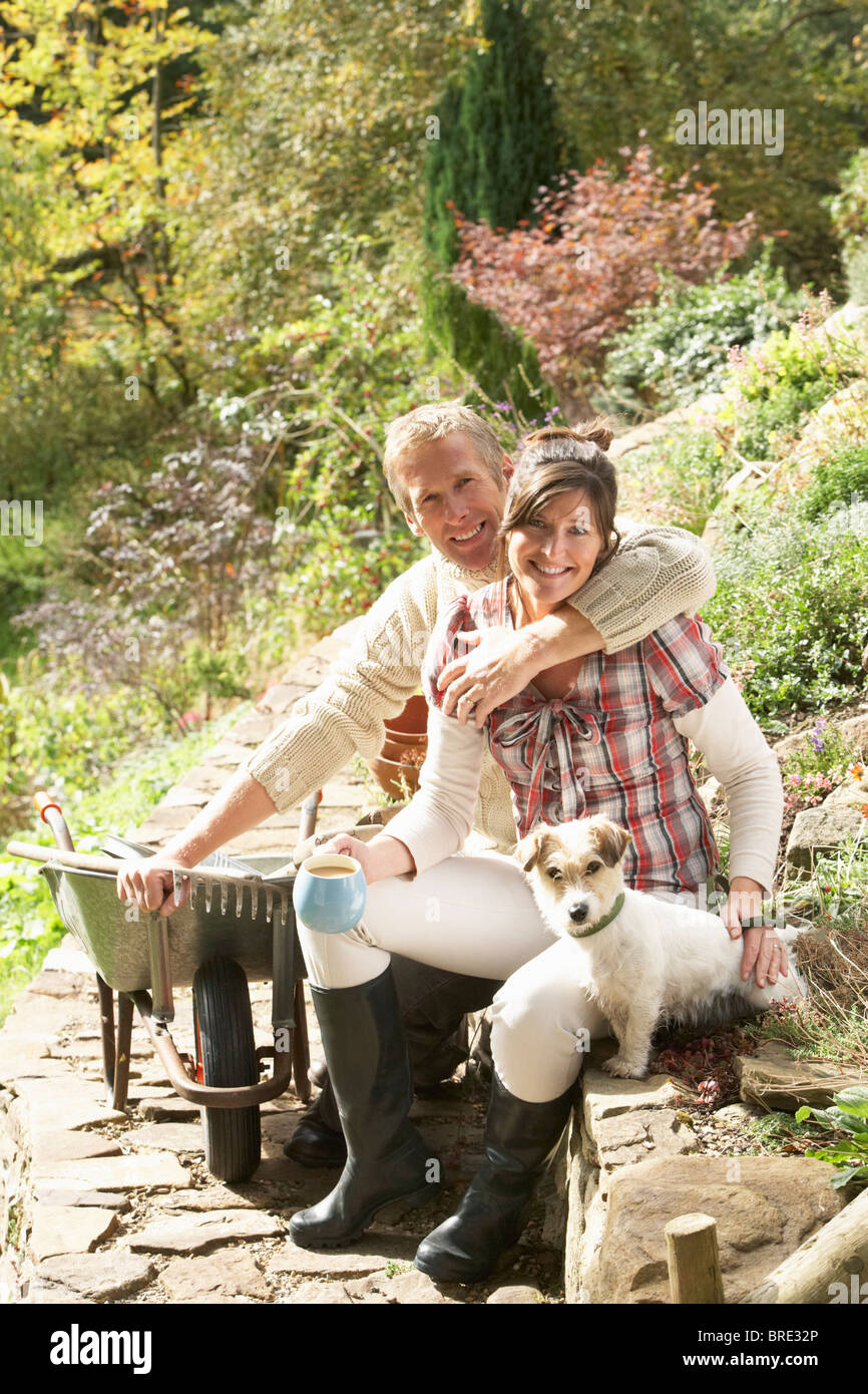 couple-with-dog-having-coffee-break-whil