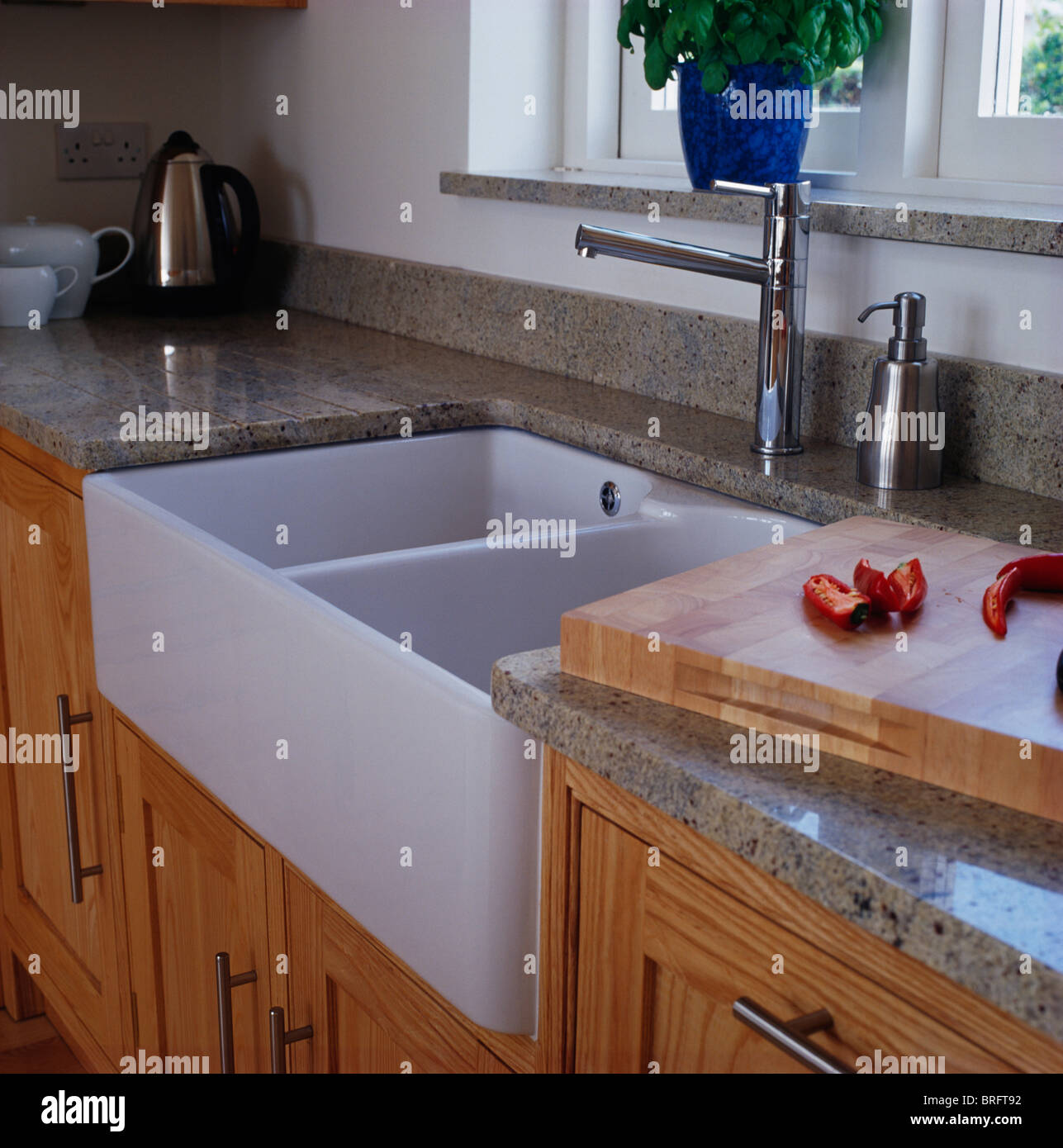 Close Up Of Double Belfast Sink And Chrome Taps In Modern Kitchen Stock Photo Royalty Free