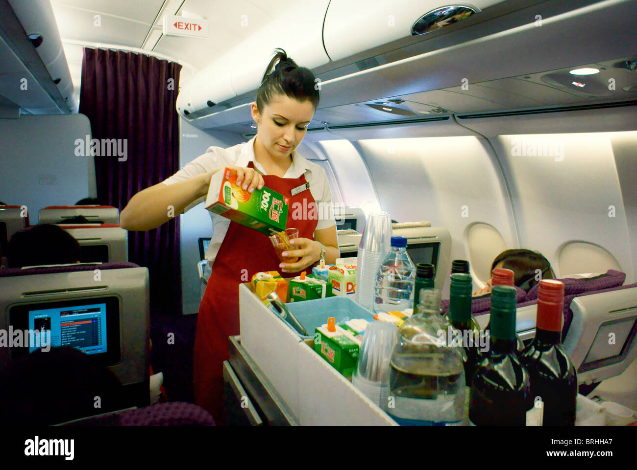 long haul flight air stewardess with food drinks aisle. Black Bedroom Furniture Sets. Home Design Ideas