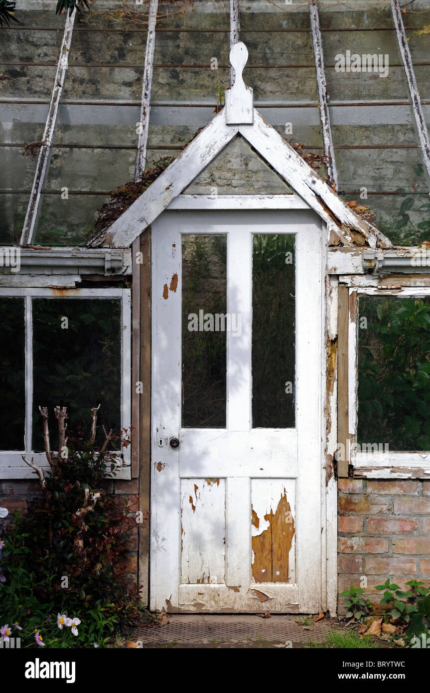 Door of into an old decrepit victorian style greenhouse for Victorian style greenhouse