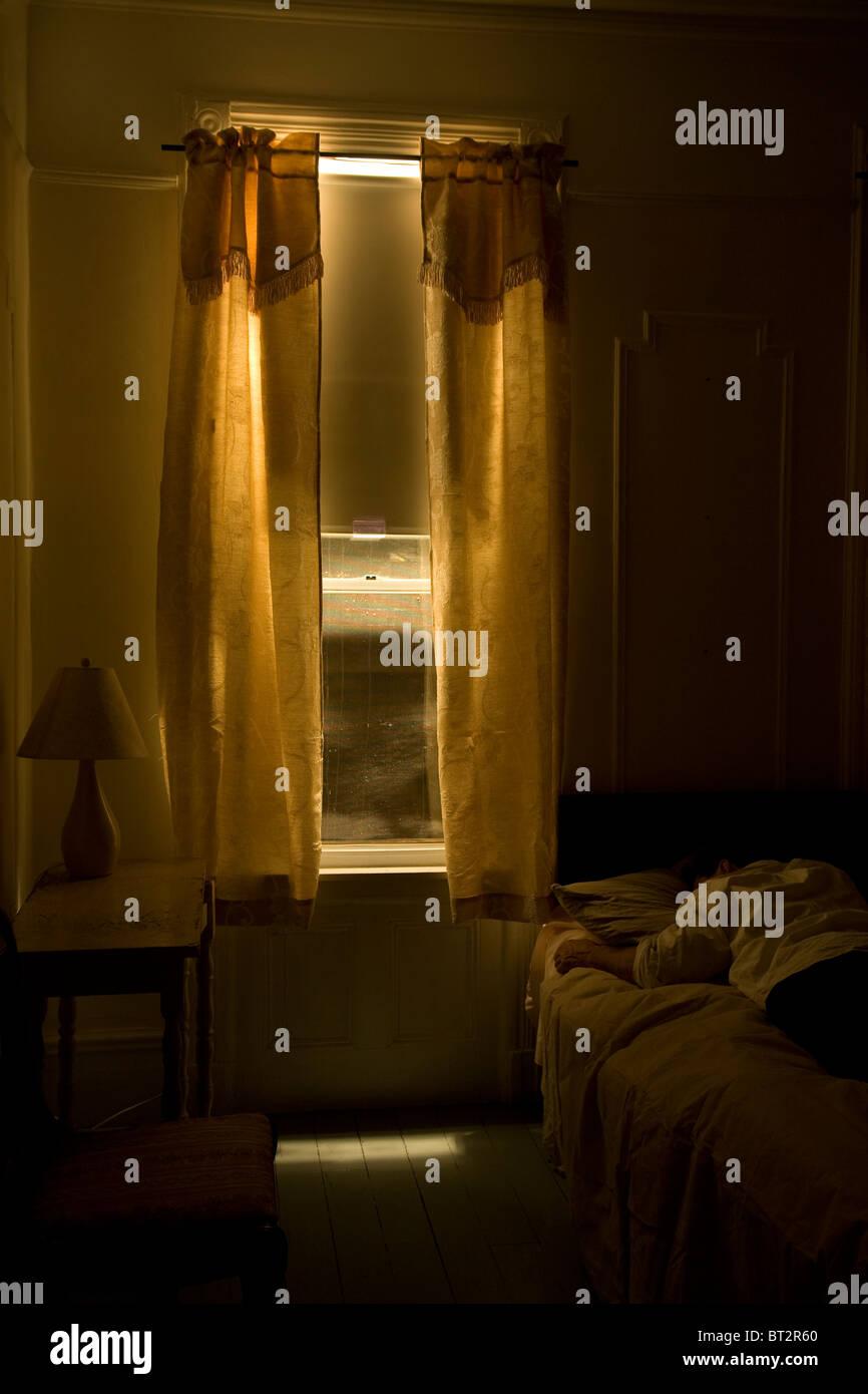 interior hotel room , man sleeping, monochromatic Stock Foto