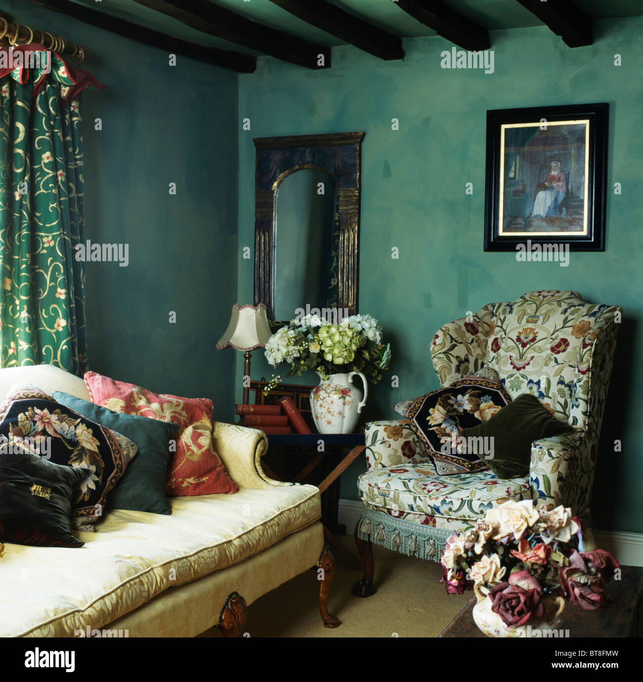 Picture on wall above patterned wing chair in dark green for Dark green living room
