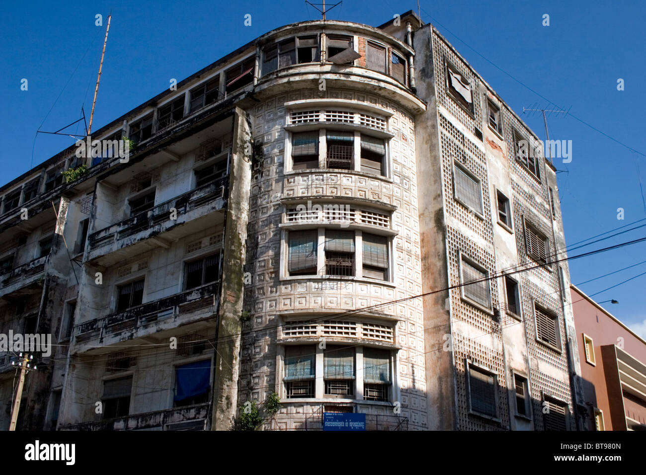 An old rundown apartment building is part of the urban ...