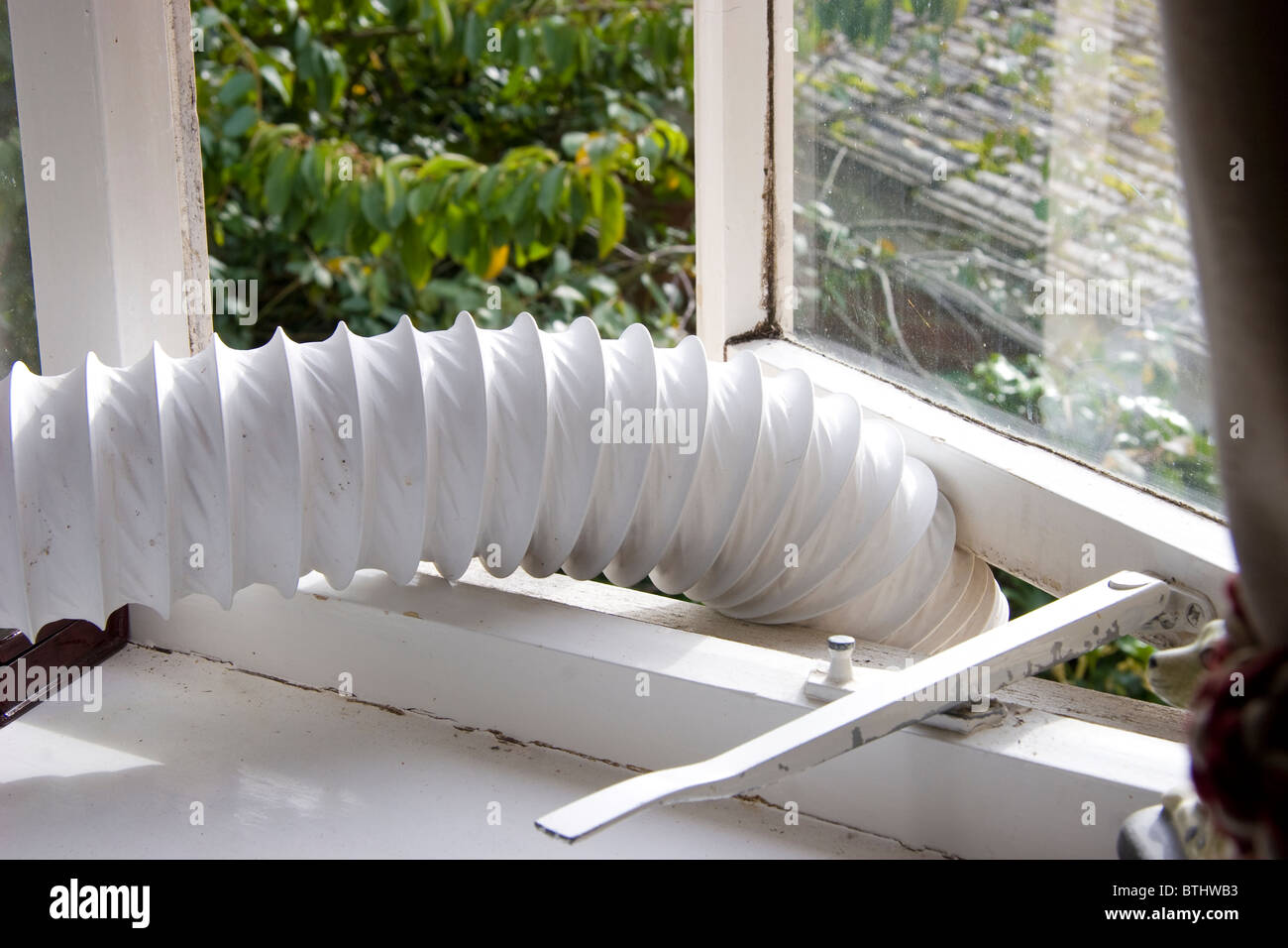 Tumble Dryer Vent Pipe Hanging Out Of A An Open Window