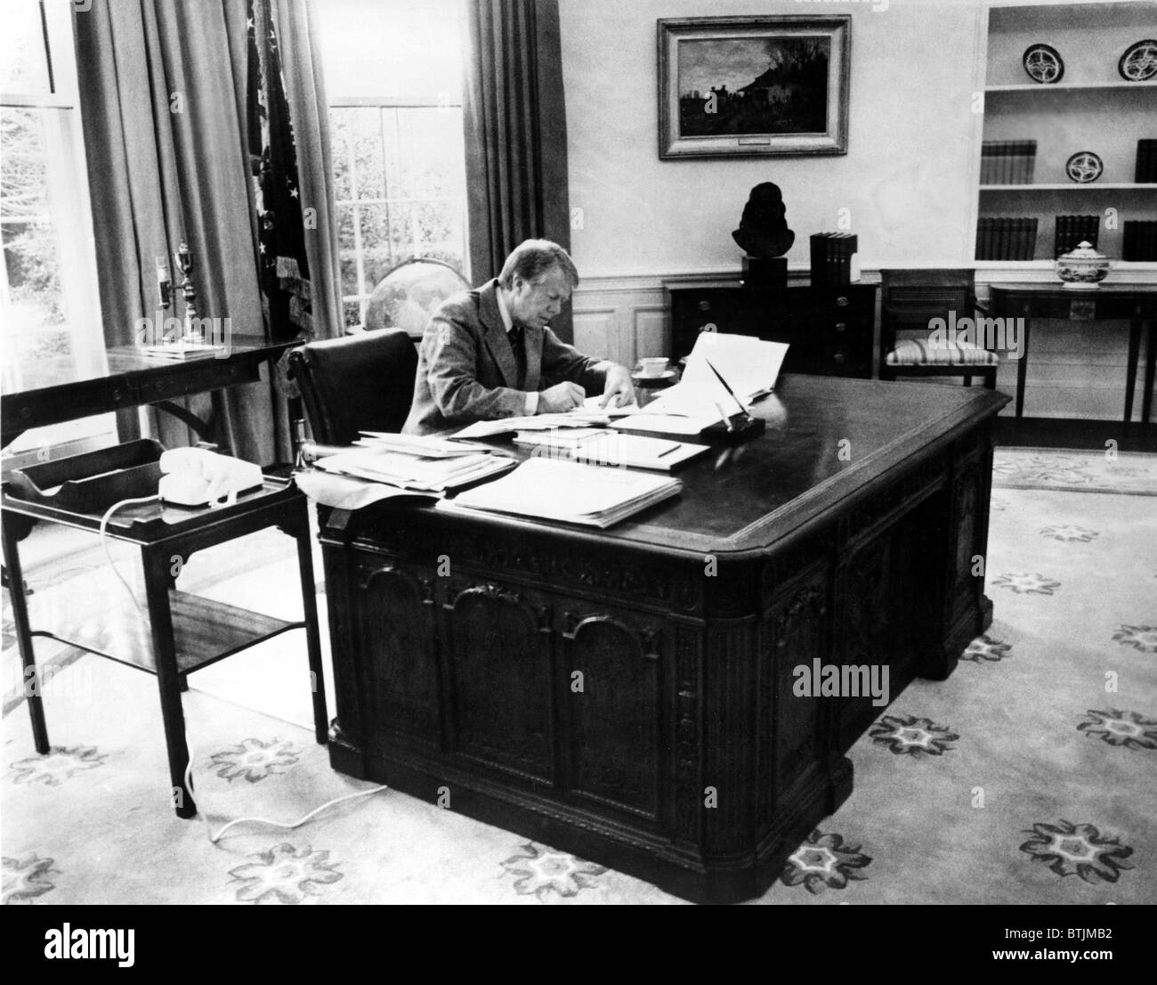 President Jimmy Carter At Work In The Oval Office Of The