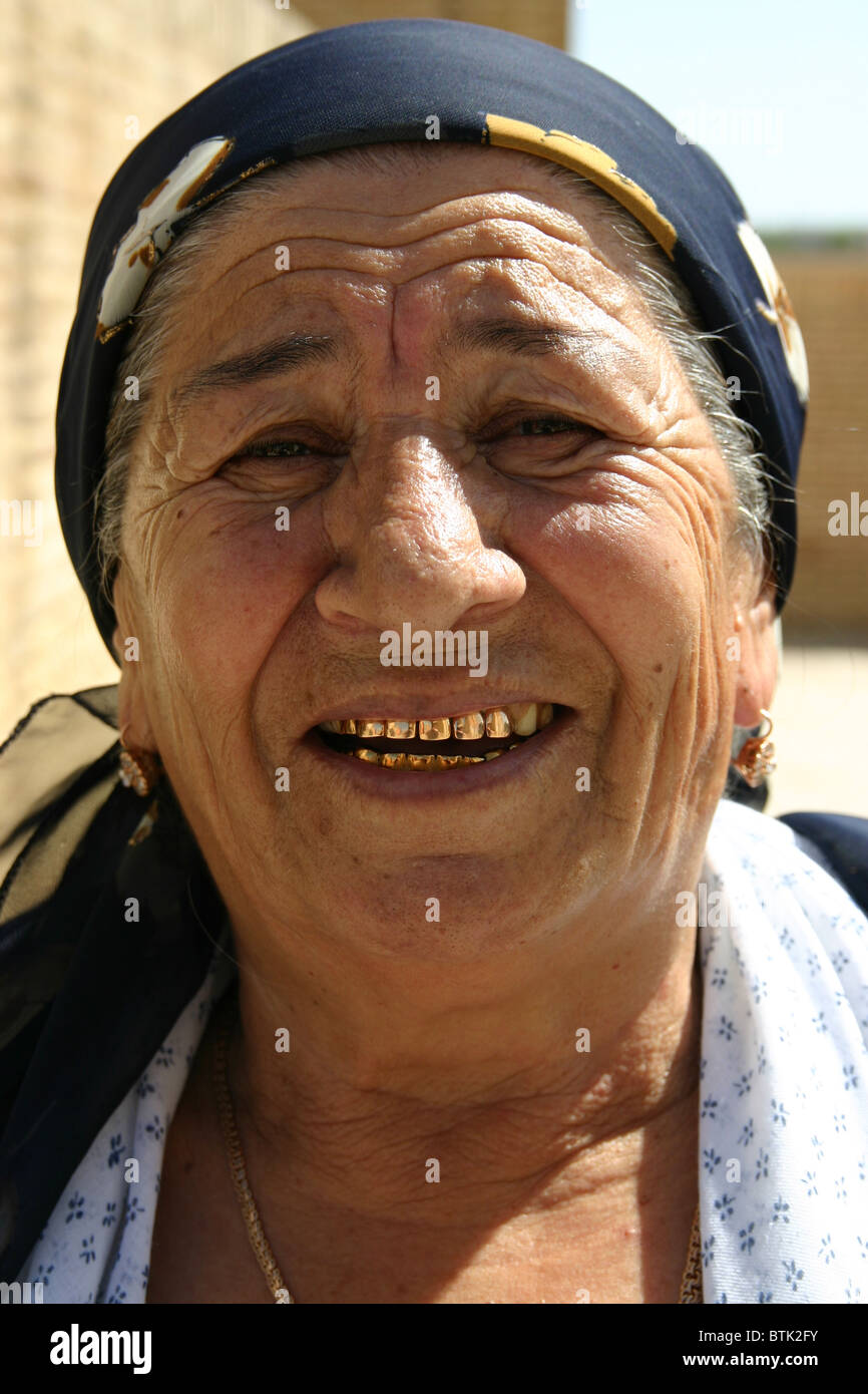Traditional Lady With Gold Teeth In Uzbekistan Stock Photo