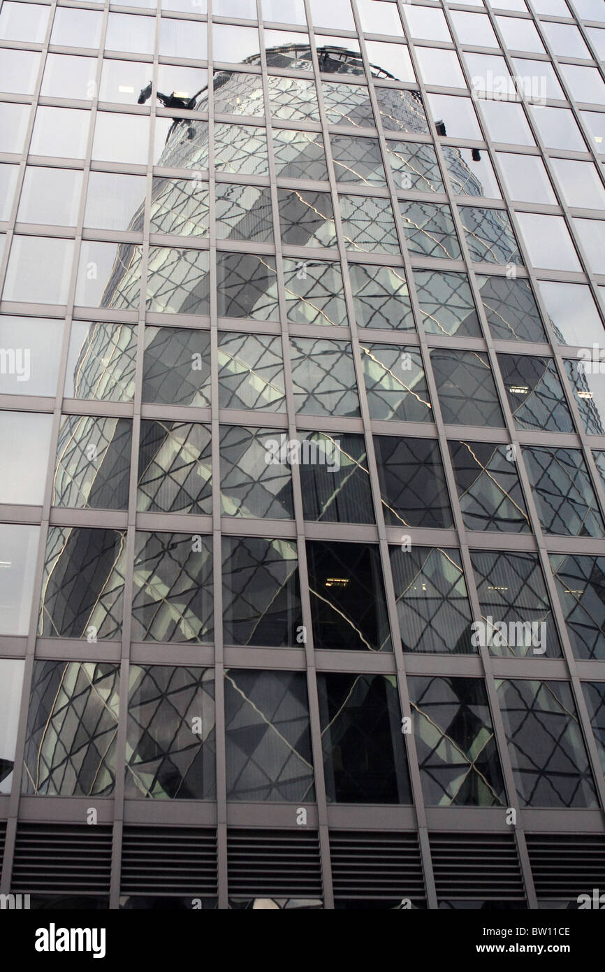 A reflection of the gherkin building seen in the glass for Refection facade