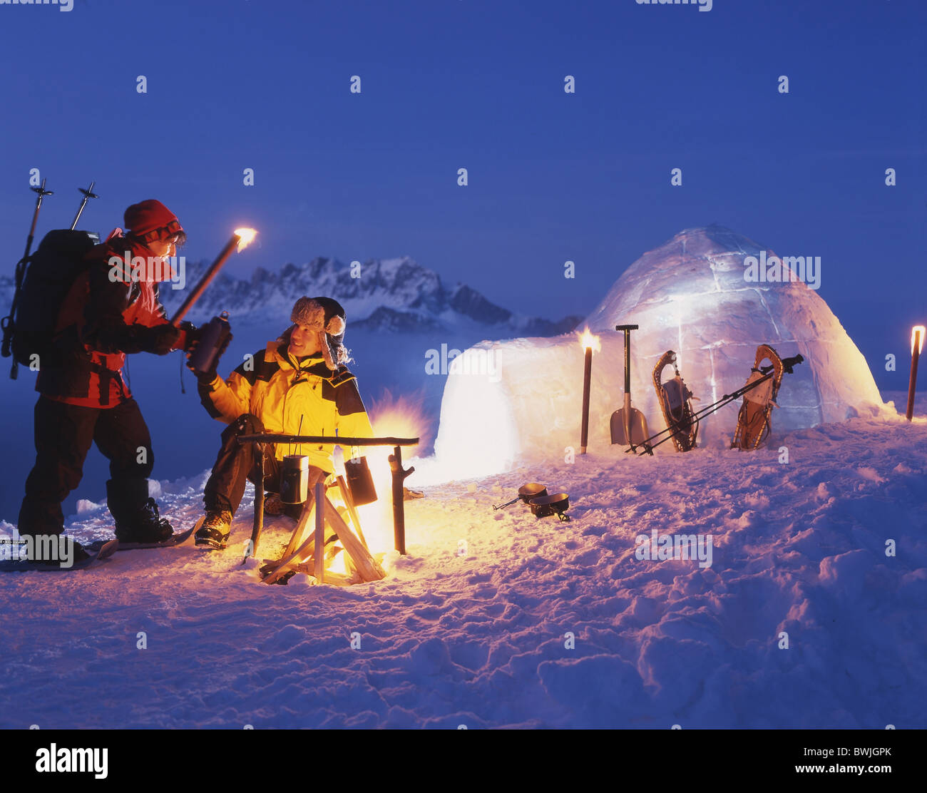 couple fire campfire torches snow shoes snow shoe walking. Black Bedroom Furniture Sets. Home Design Ideas