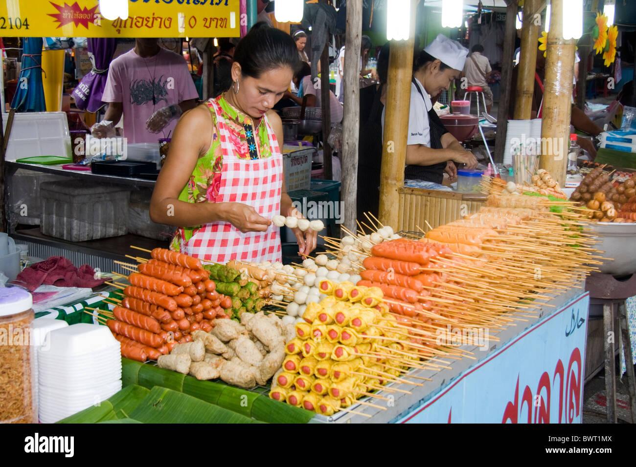 woman-vendor-selling-skewered-food-on-ph