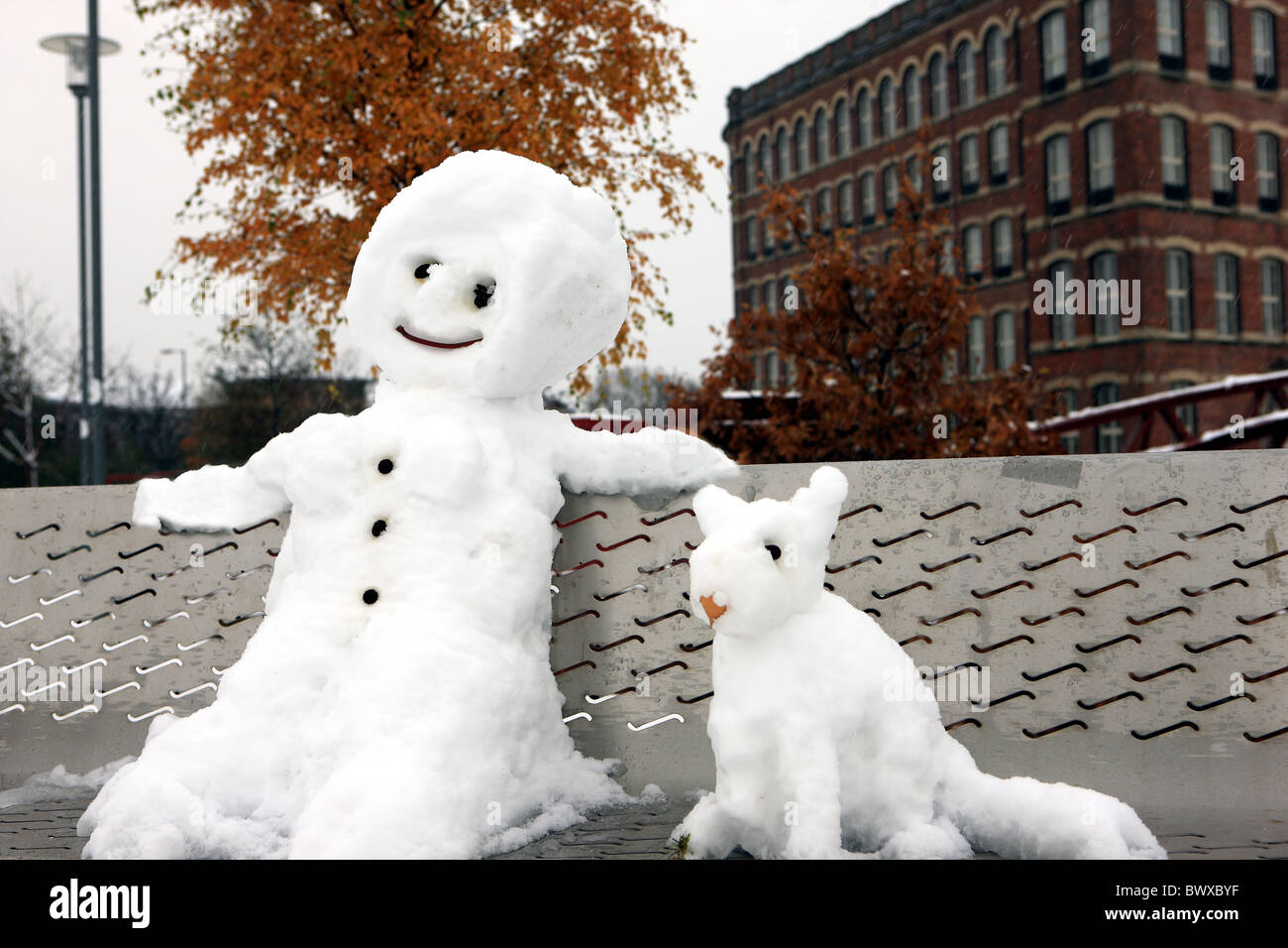 snowman-and-dog-sitting-on-a-park-bench-