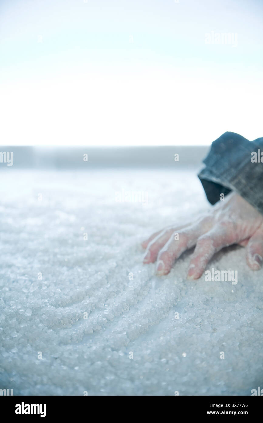 frozen hand lying on snow and ice. exterior location, Stock Foto