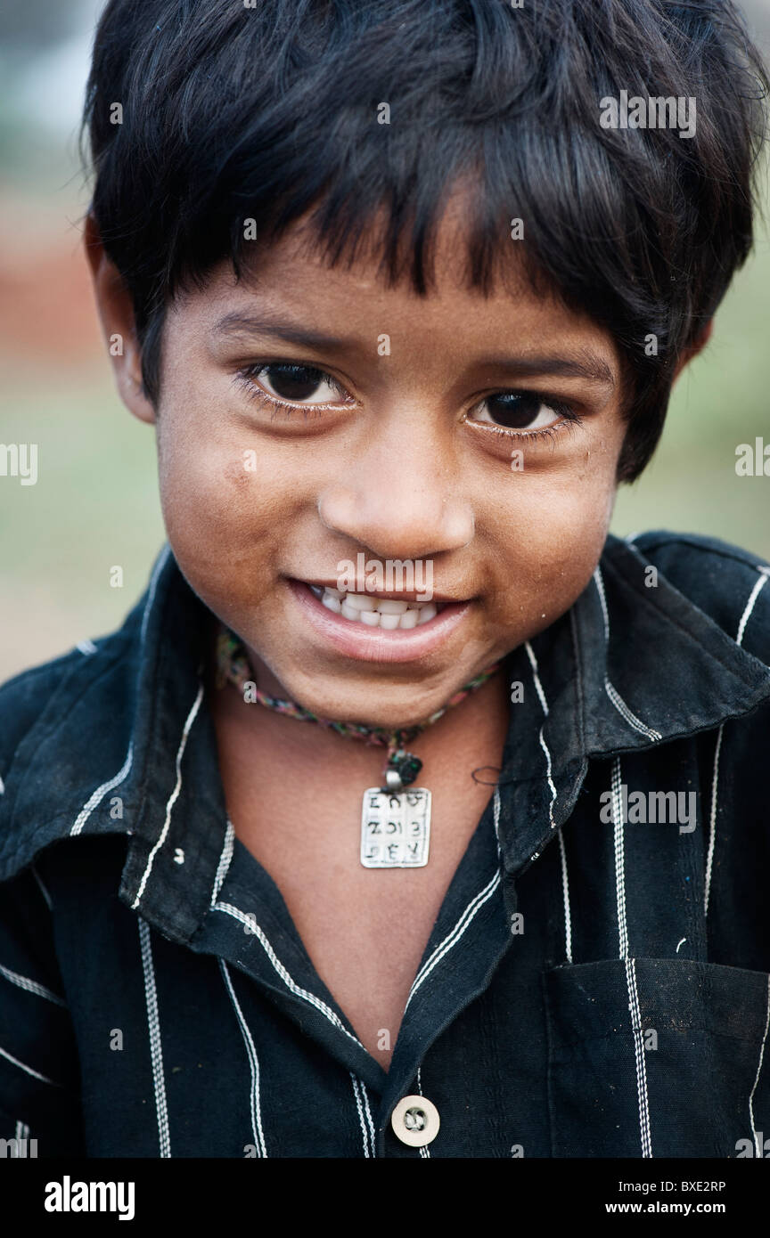 Young poor lower caste Indian street boy smiling. Andhra Pradesh, India Stock Photo