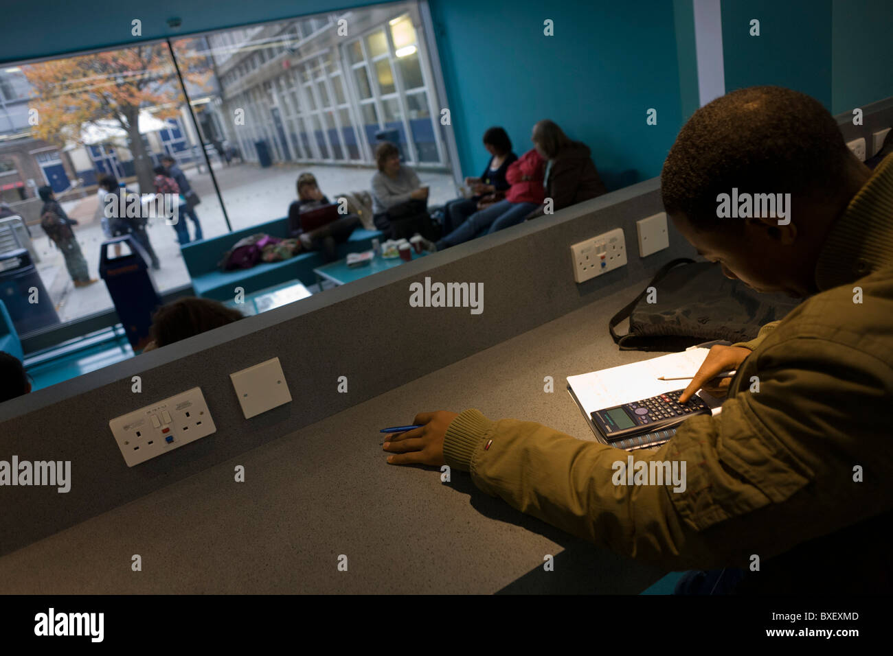 young-man-studies-at-workstation-in-comm