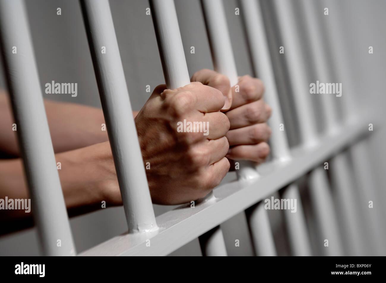 hands-on-prison-bars-BXP06Y.jpg