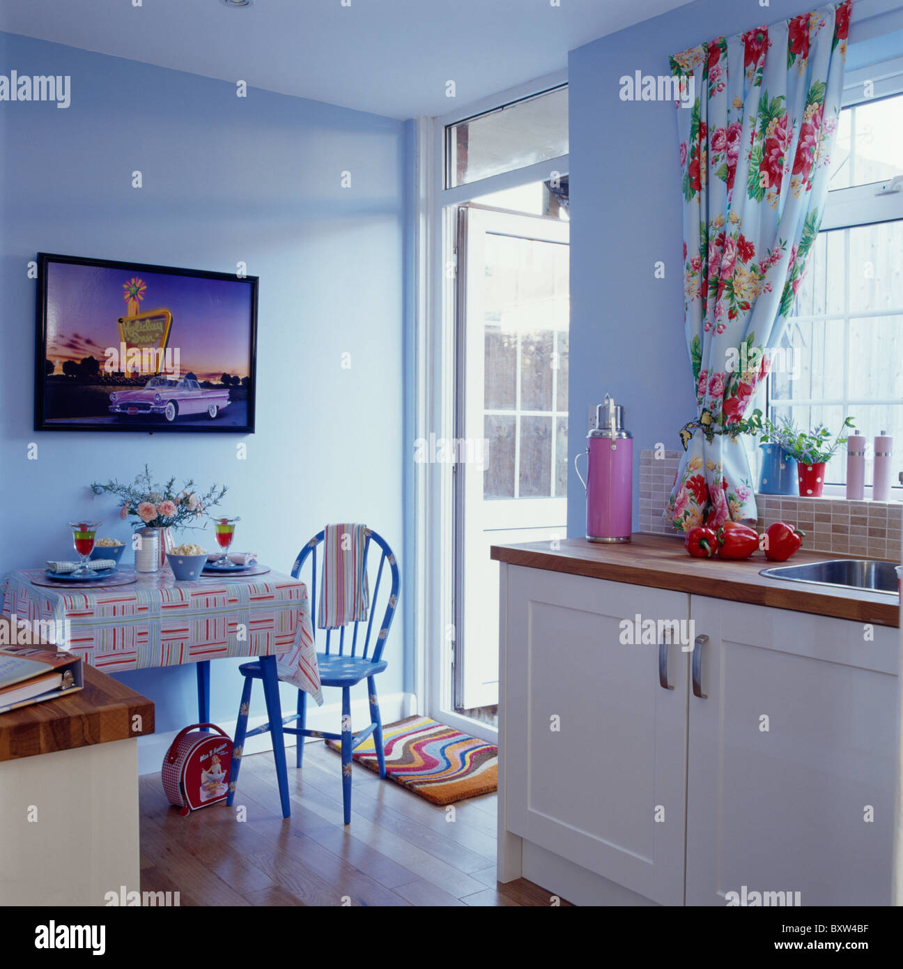 Blue Kitchen Table And Chairs: Large Picture On Wall Above Small Table And Chair In Pale