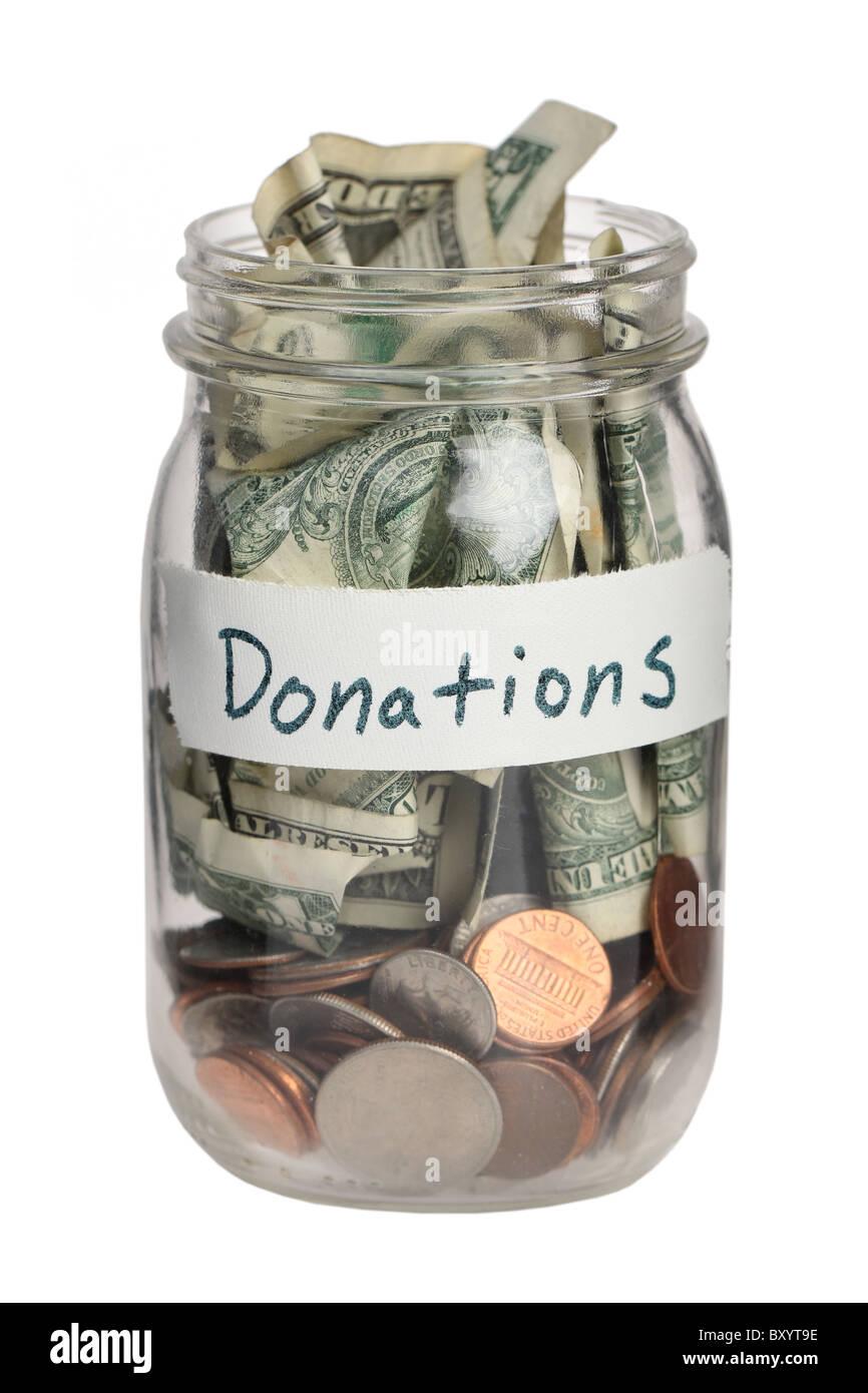 Donation jar on white background Stock Photo, Royalty Free ...