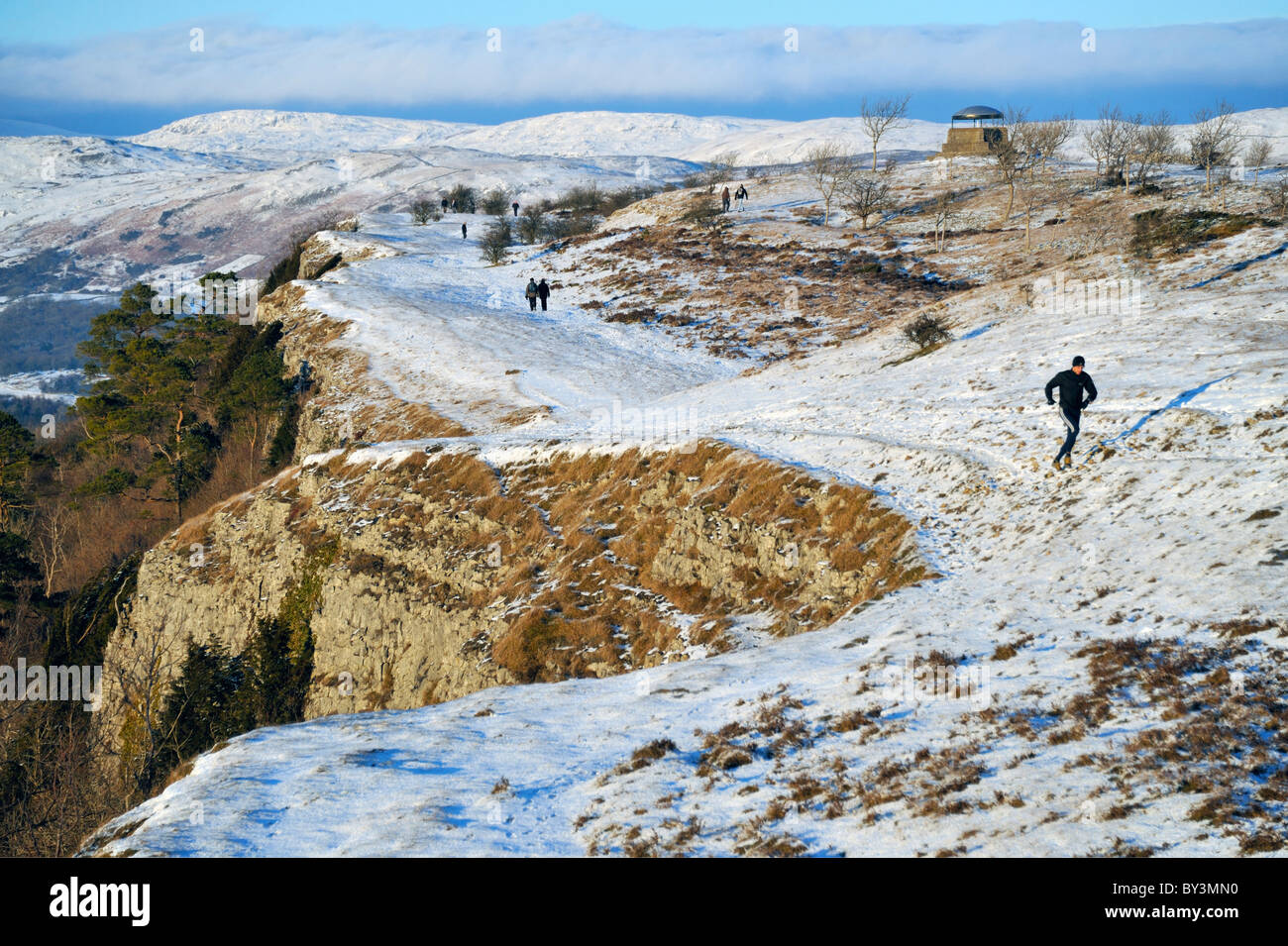 Walkers and runner on Scout Scar, Kendal, Cumbria, England, United Kingdom, Europe. Stock Photo