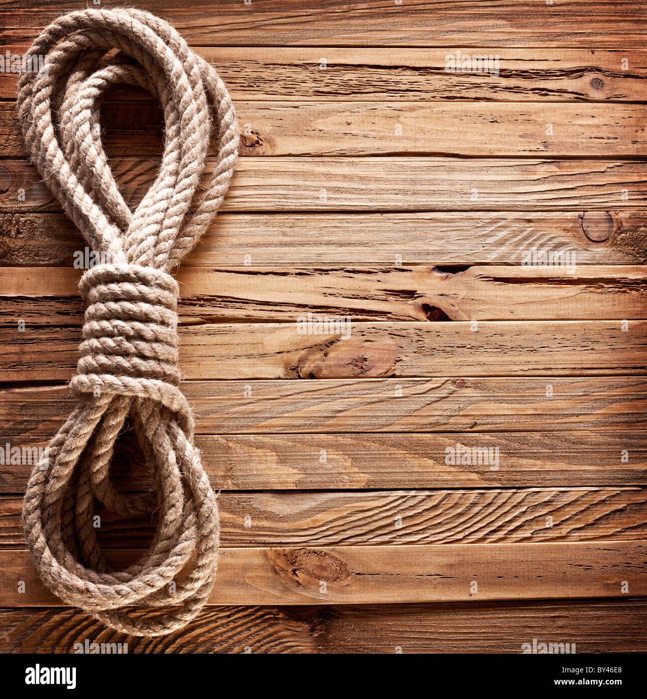 Brown Wooden Board With Rope: Image Of Old Texture Of Wooden Boards With Ship Rope Stock