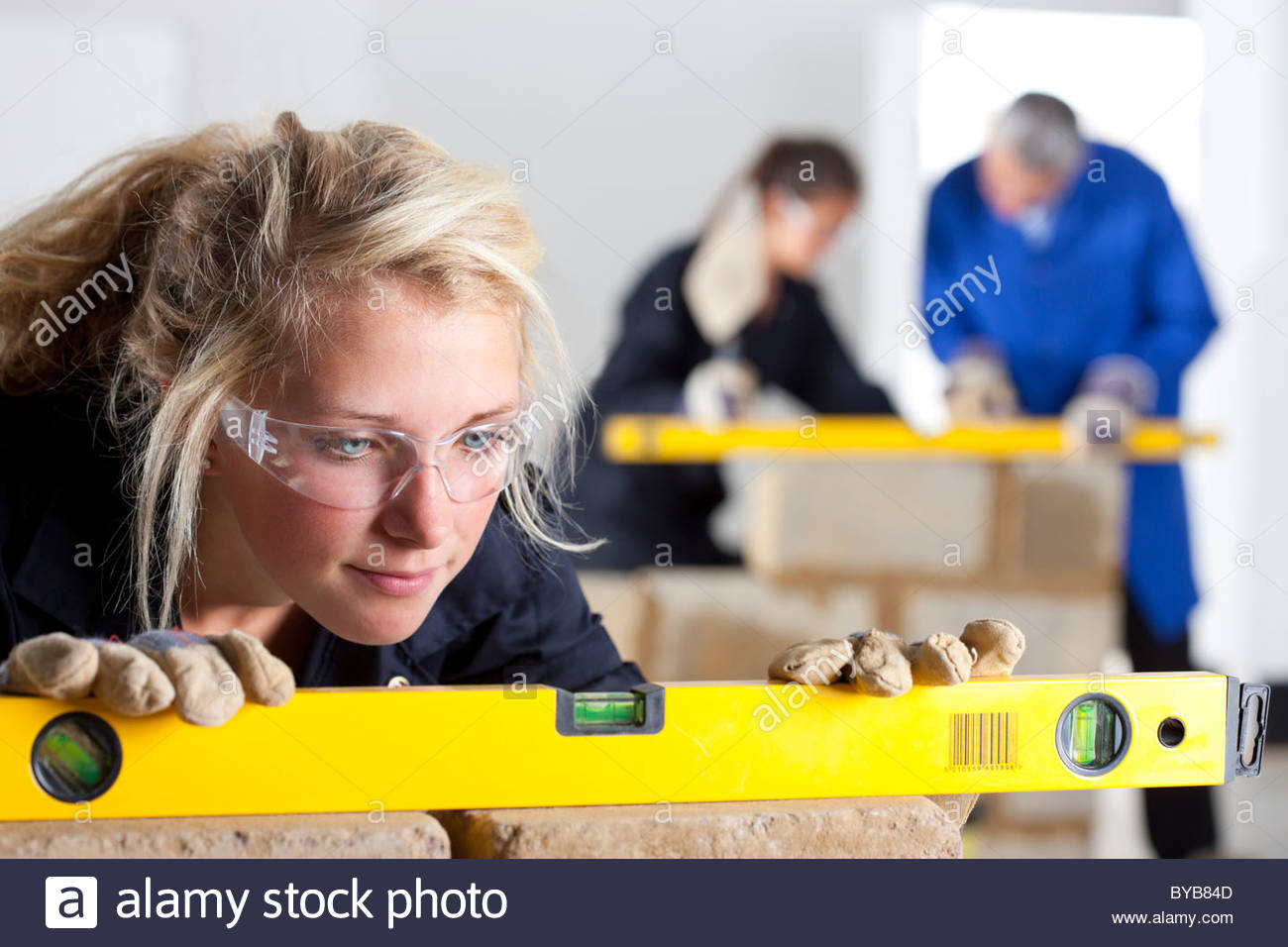 Student using level in bricklaying vocational school Stock Photo