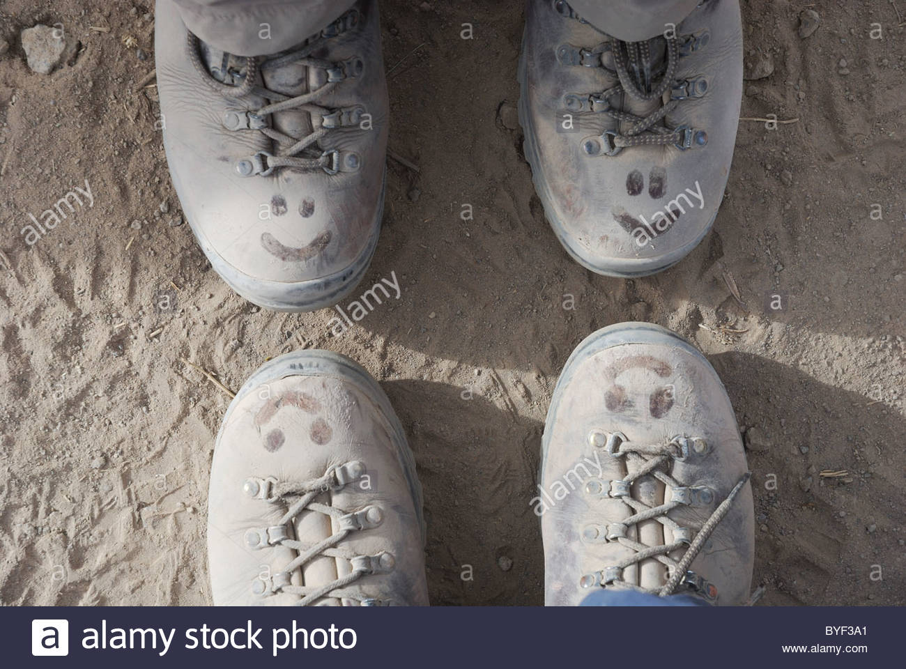 smiley-faces-on-dusty-walking-boots-BYF3A1.jpg
