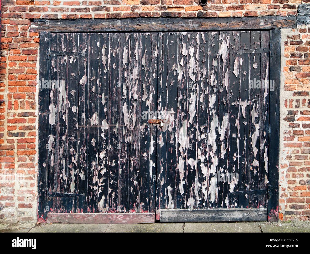 Old Garage Doors : Old wooden garage door in need of redecoration with black