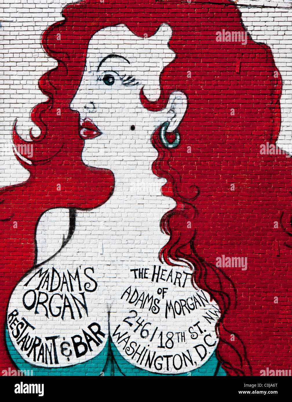 landmark-mural-of-a-buxom-lady-on-the-side-of-club-madams-organ-on-C0JA6T.jpg