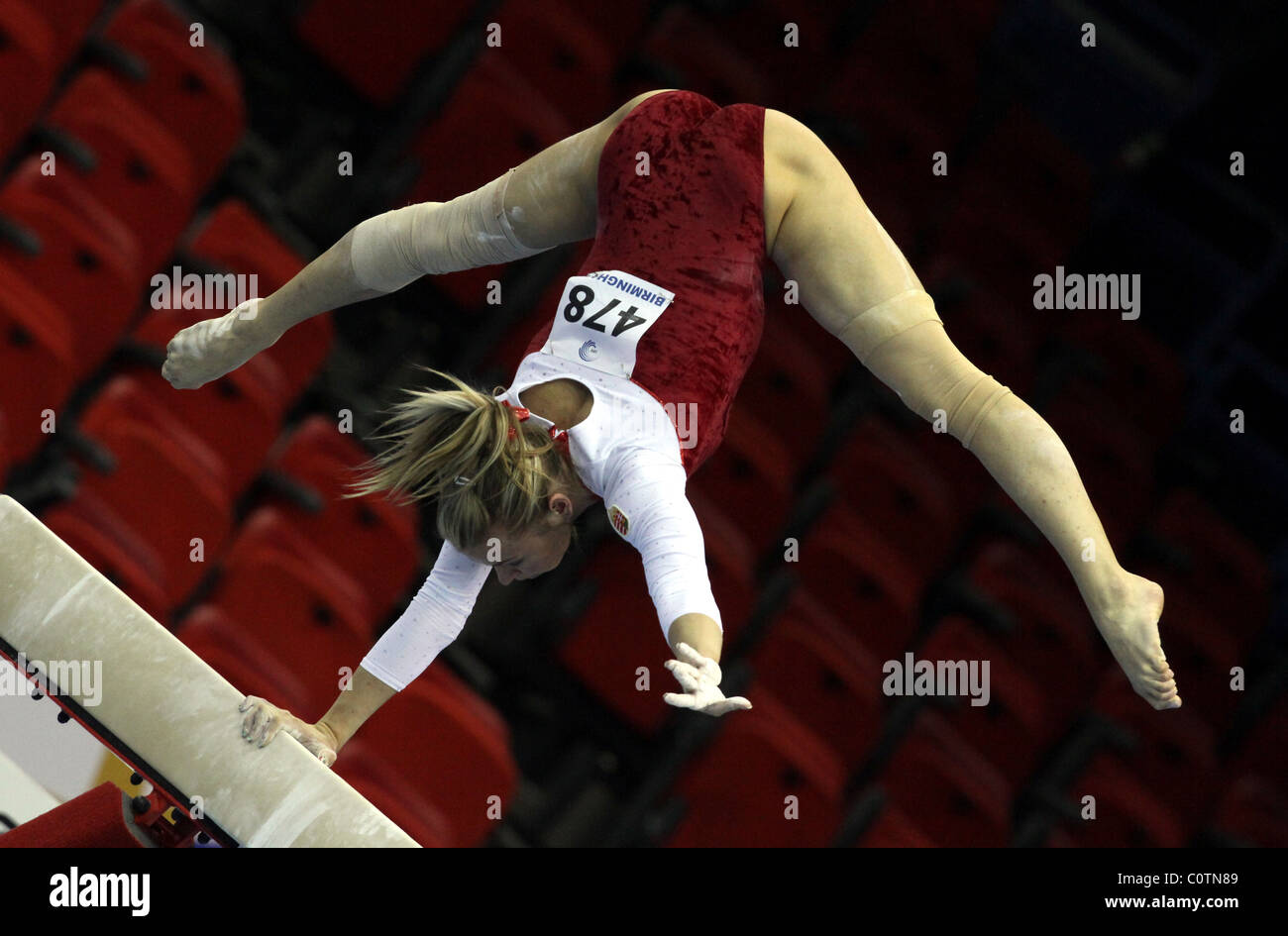 Female Gymnast Performs A Handstand Using Only One Arm On