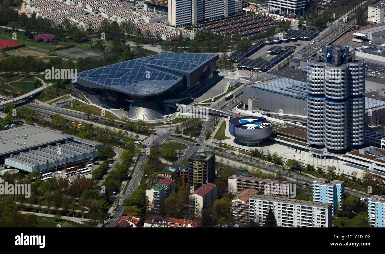 aerial view above BMW world corporate headquarters including the four cylinder tower and BMW Lifestyle Shop Munich Stock Photo
