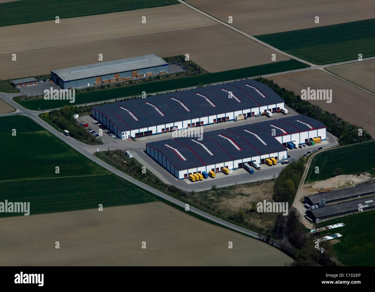 aerial view above warehouse roof covered with solar panels Bavaria Germany Stock Photo