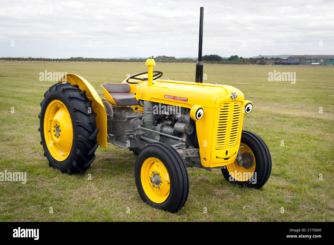 Massey Ferguson Model 35 : A massey ferguson model painted yellow and grey with