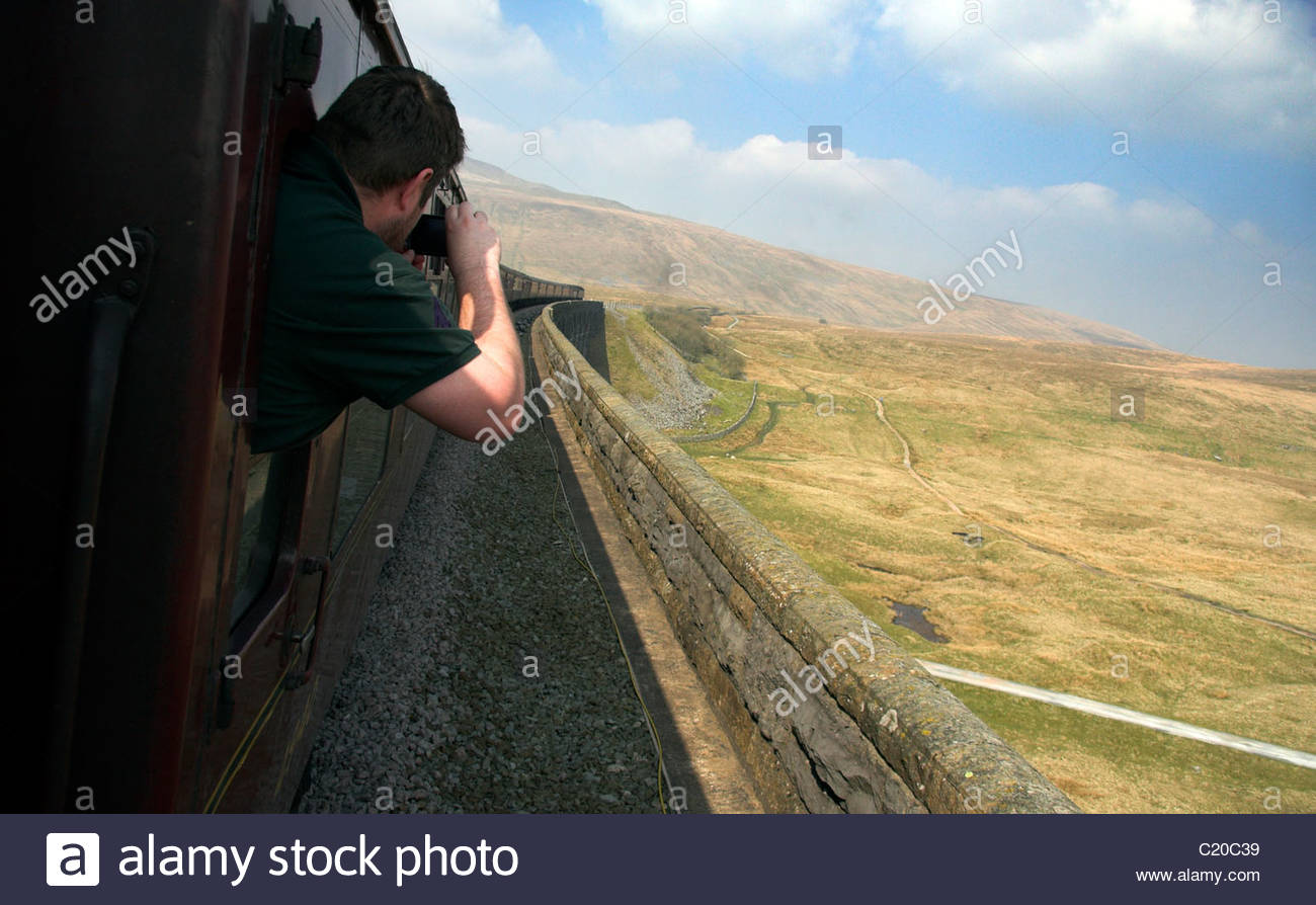 passenger-taking-a-photo-as-the-train-tr