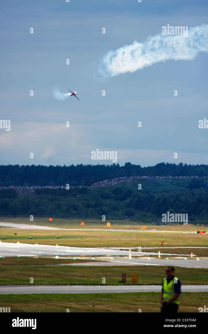UK Air Force Red Arrows display team British Aerospace Hawk T1 thrills crowds at Farnborough International Airshow Stock Photo