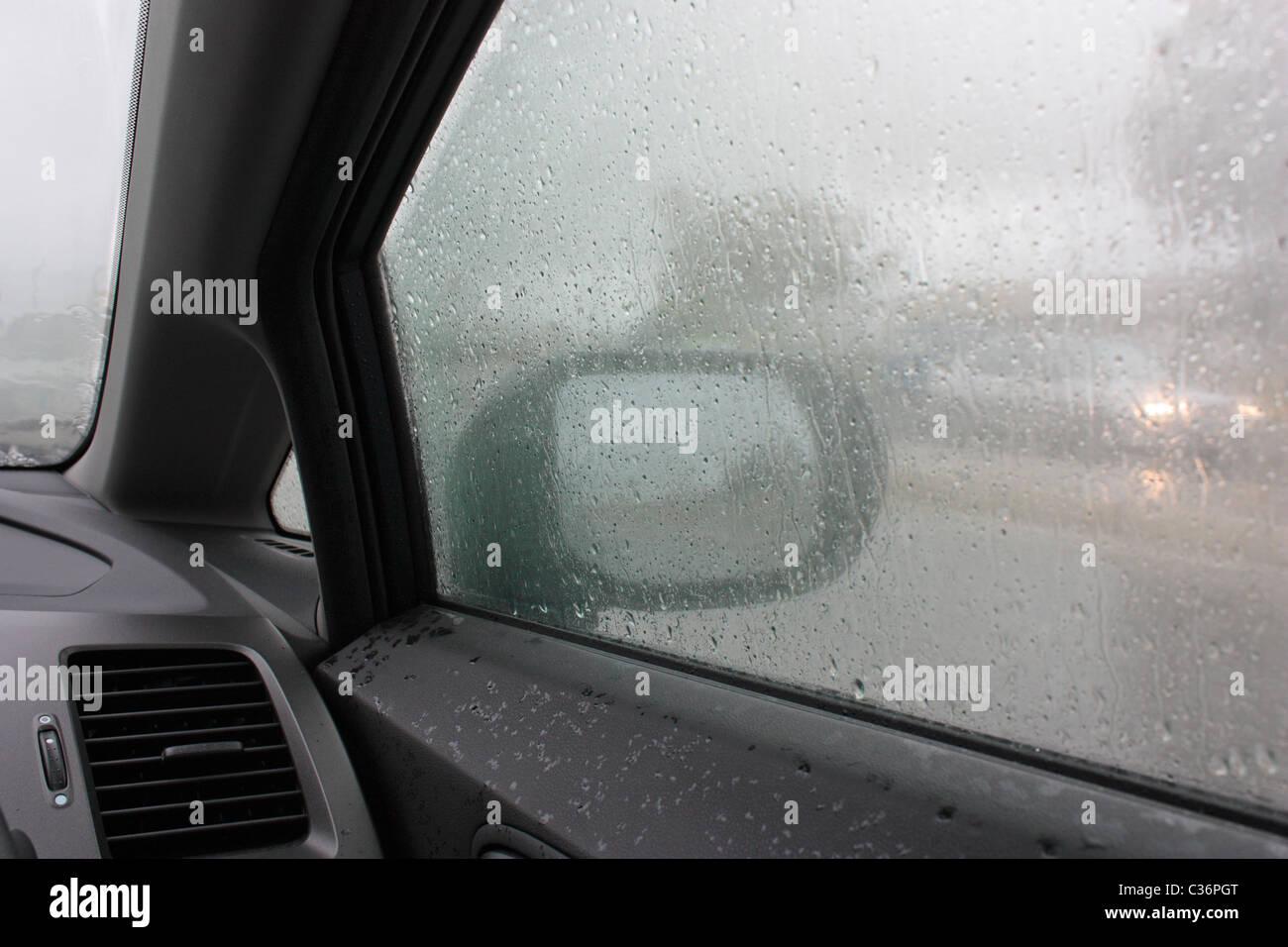 in-a-car-in-the-rain-C36PGT.jpg