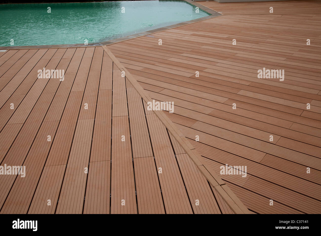 Decking platform around swimming pool made from recycled for Recycled decking material