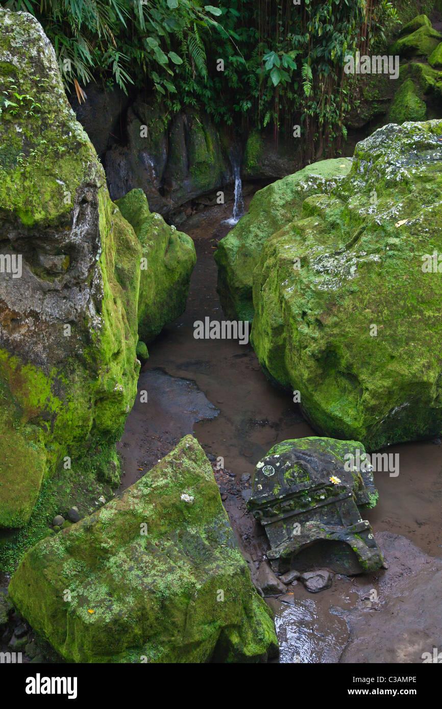 Stone carved ruins at the hindu shrine goa gajah also