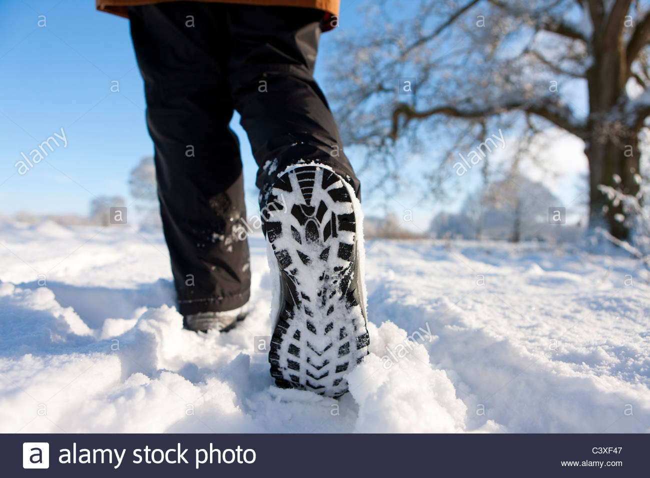 Close Up Of Woman 39 S Feet Walking Through Field Of Snow