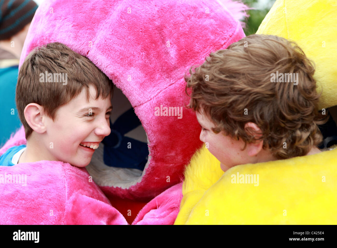 two-boys-laughing-as-they-put-on-the-hea