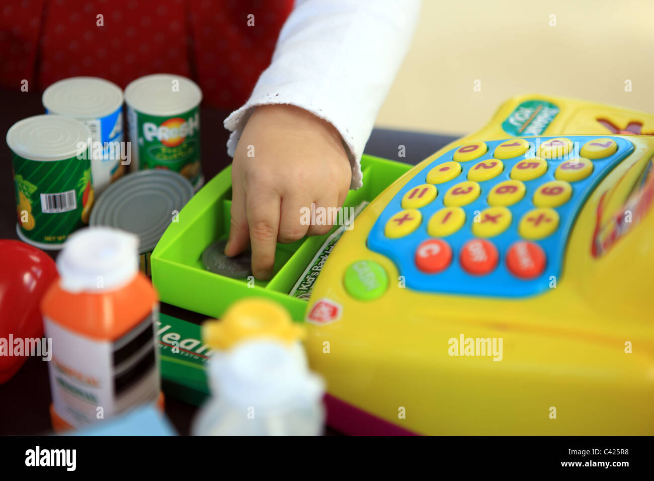 playing-with-a-toy-cash-register-C425R8.