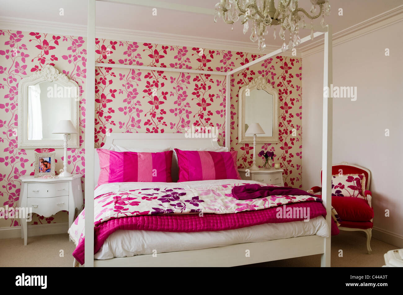 White fourposter bed in bedroom with designer 39 s guild pink for Designer s image