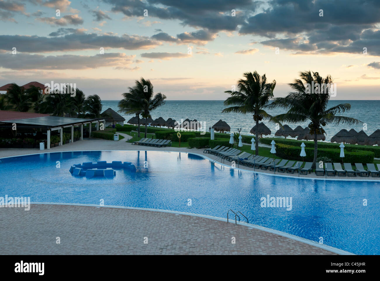 sunrise over the caribbean sea at a vacation resort on the. Black Bedroom Furniture Sets. Home Design Ideas