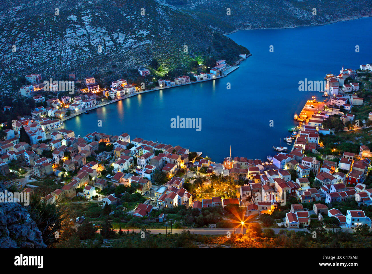 Panoramic view of the village and harbor of Kastellorizo island from the path that goes to Saint George Monastery. Stock Foto
