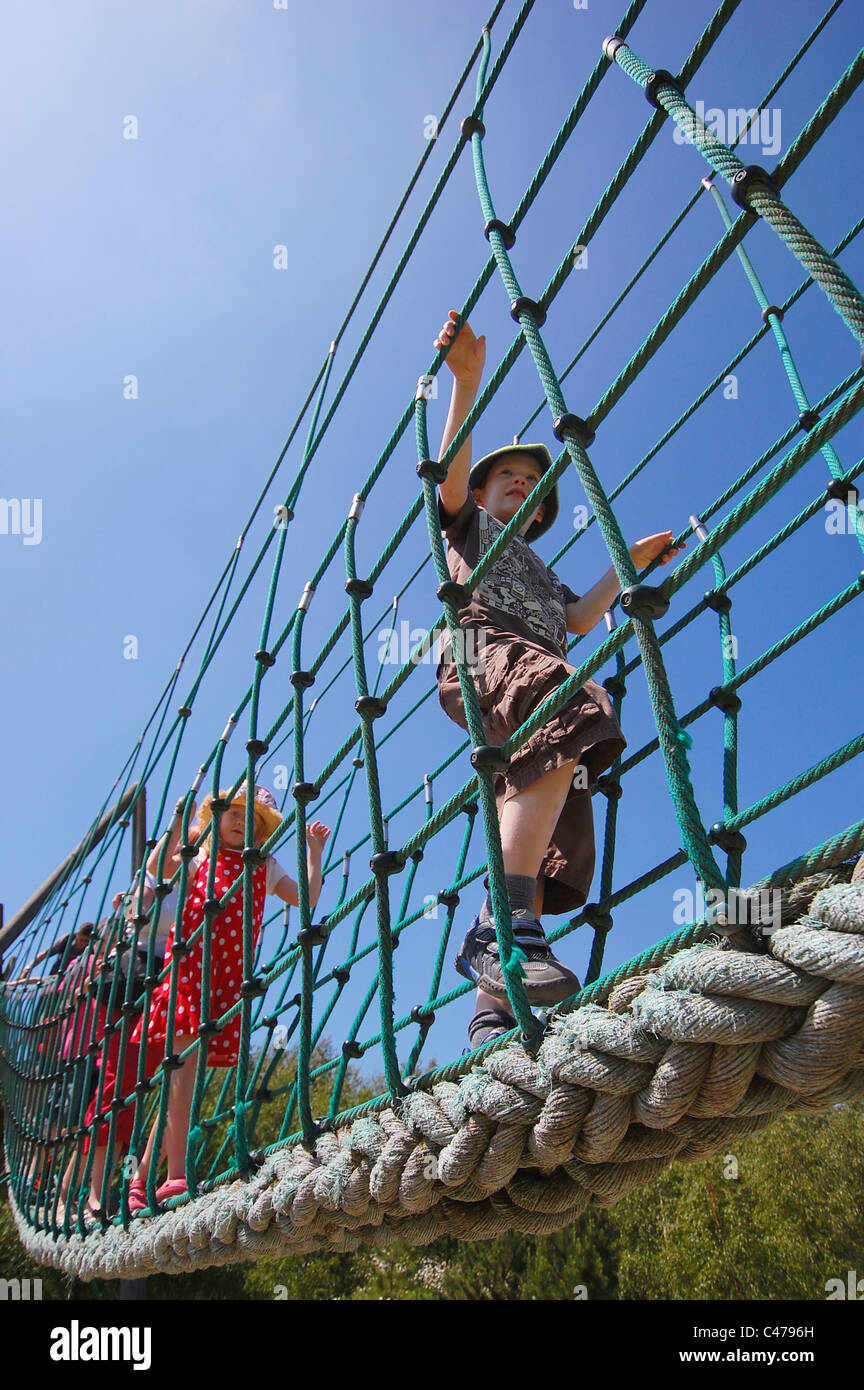 children-walking-across-a-rope-bridge-vi